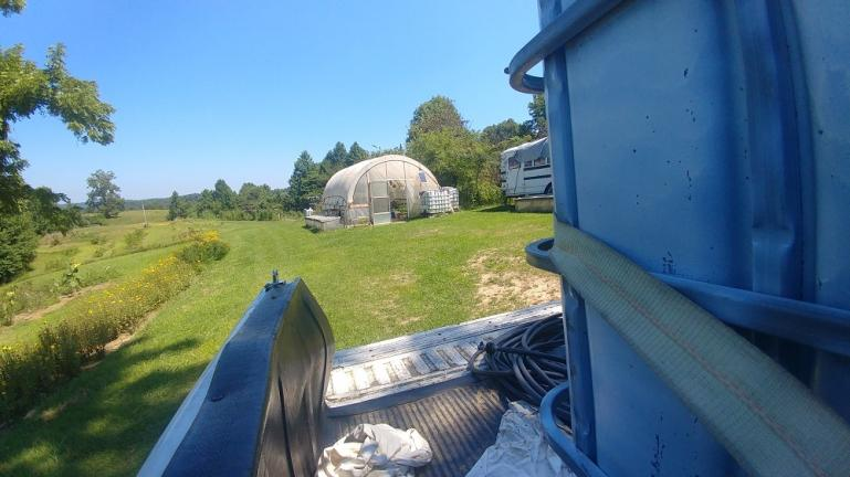 Gravity fed water transfer from 4000 gallon collection tank to field tanks.