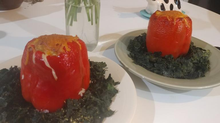 Stuffed red peppers on a bed of baked kale    8-30-19