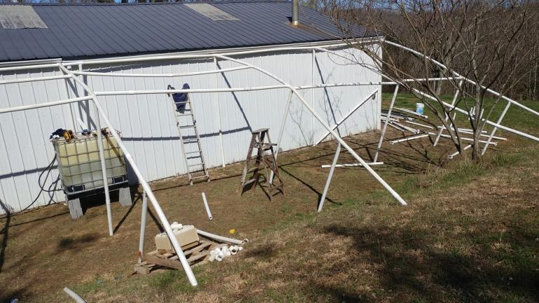 In WV we had built a 20x40 rebar and PVC Greenhouse because we had anticipated the possibility of wanting to move somewhere else and wanted to be able to take our greenhouse with us.  This is my 1st attempt at assembling the pieces here in Weed.