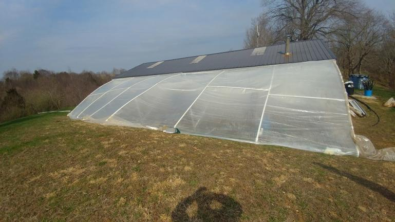 PVC greenhouse 2nd attempt.  After installing more support poles and configuring the horizontal beams differently... this version collapsed in about a week after a flash flood.