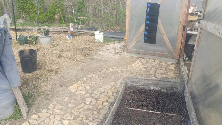 Rock path into the Greenhouse   Raised beds behimd the green house get shade all day for summertime lettuce and spinach.