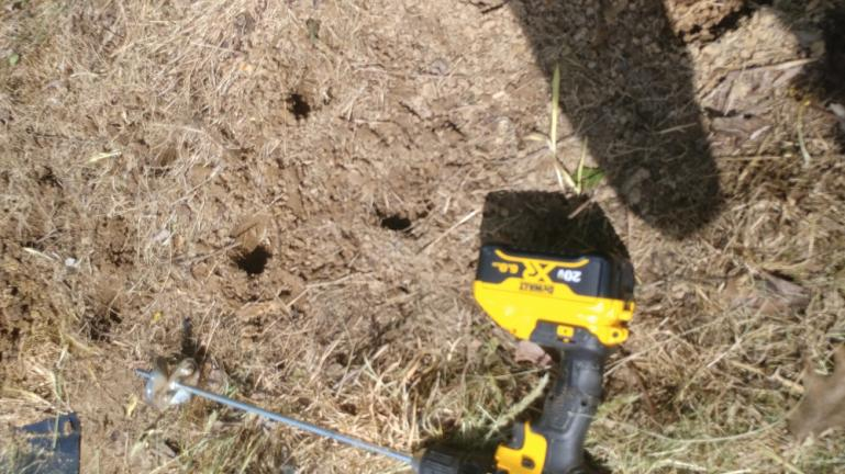 Transplant and Bulb Drill.  This cordless drill attachment drills a cup into the dirt; saves time and works great for transplants and bulbs... not so much for seeds.
