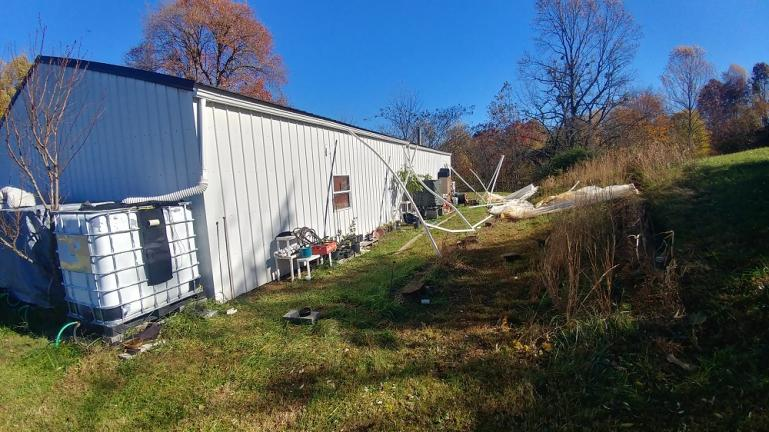 11-6-18 The LAST PVC Greenhouse.  Destroyed by a tornado warning.  The greenhouse was lifted up atleast 3ft off its rebar supports and most poles were broken and scattered.  This was the 4th version of this greenhouse recreated from the pvc structure that survived winters before we moved to this super windy ridge line.   :~(
