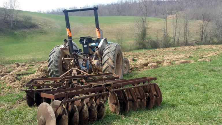 Preparing to Disc the Plowed field